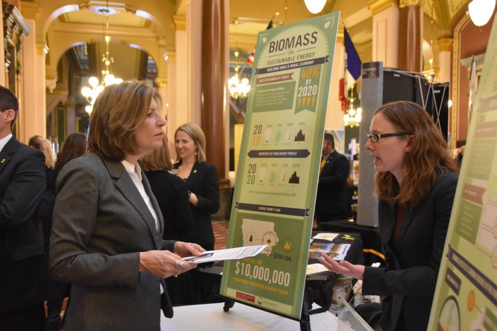 Tax credits are given for industries that converting biomass into sustainable energy. Senator Rita Hart is shown above learning about this technology that has helped Iowa achieve economic success.